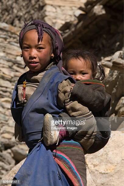 Tibetan Sisters In Phu Village On The Nar Phu Trek Annapurna Conservation Area Nepal