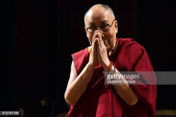 Tibetan spiritual leader and Nobel laureate Dalai Lama gestures during a ceremony making him an honorary citizen of the Italian city of Milan at the...
