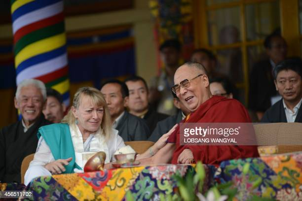 Tibetan spiritual leader His Holiness the Dalai Lama shares a light moment with Nobel Peace Prize laureate Jody Williams during a commemoration event...