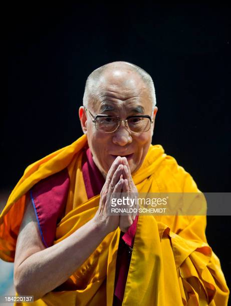 Tibetan spiritual leader in exile Tenzin Gyatso the 14th Dalai Lama gestures during the Programme of Buddhist Teachings in Mexico City on October 12...