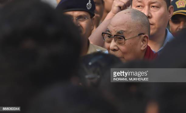 Tibetan spiritual leader Tenzin Gyatso the 14th Dalai Lama interacts with school students after arriving for a private teaching and talk session in...