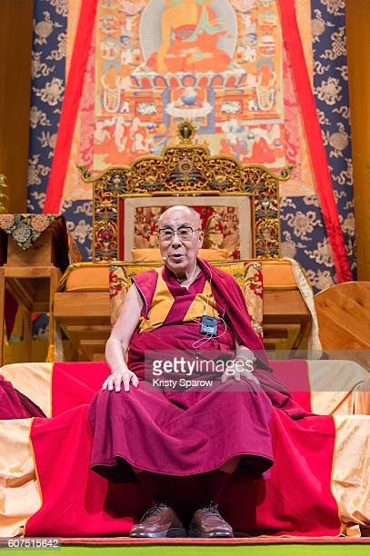 Tibetan Spiritual Leader the 14th Dalai Lama speaks on stage during a Buddhist teaching at the Le Zenith on September 18 2016 in Strasbourg France...