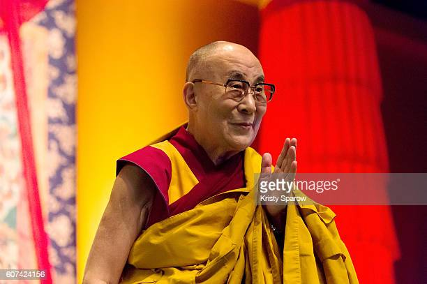 Tibetan Spiritual Leader the 14th Dalai Lama speaks on stage to give a Buddhist teaching at the Le Zenith on September 18 2016 in Strasbourg France...