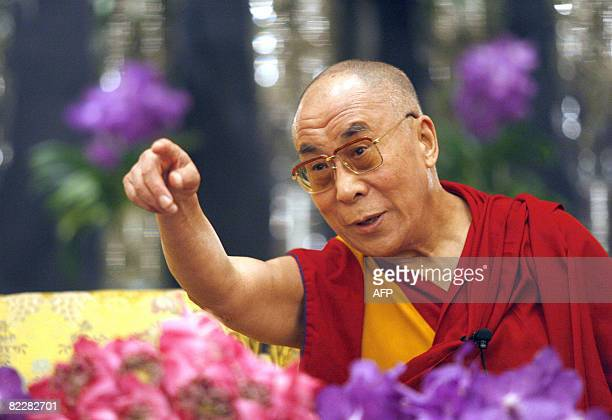 Tibetan spiritual leader The Dalai Lama answers journalist's questions during a press conference on August 13 2008 in Paris The Dalai Lama said today...