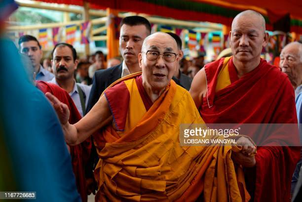 Tibetan spiritual leader the Dalai Lama arrives for a longlife prayer offering dedicated to him at Tsuglagkhang Temple in McLeod Ganj on September 13...