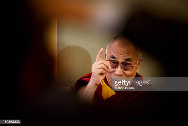 Tibetan spiritual leader the Dalai Lama attends a press conference during the 17th Forum 2000 Conference on September 17 2013 in Prague Czech Republic