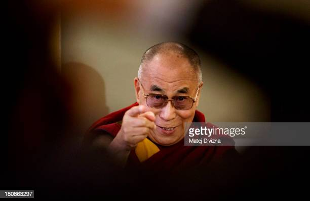Tibetan spiritual leader the Dalai Lama attends the press conference during the 17th Forum 2000 Conference on September 17 2013 in Prague Czech...
