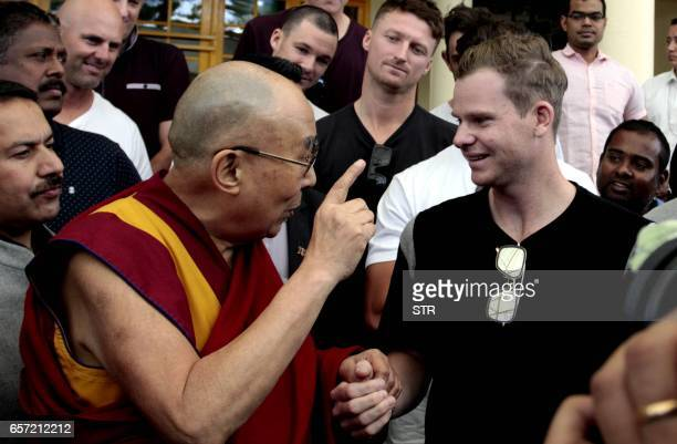 Tibetan Spiritual Leader The Dalai Lama gestures as he speaks with Australian touring cricket captain Steve Smith at his residence in Dharamsala on...