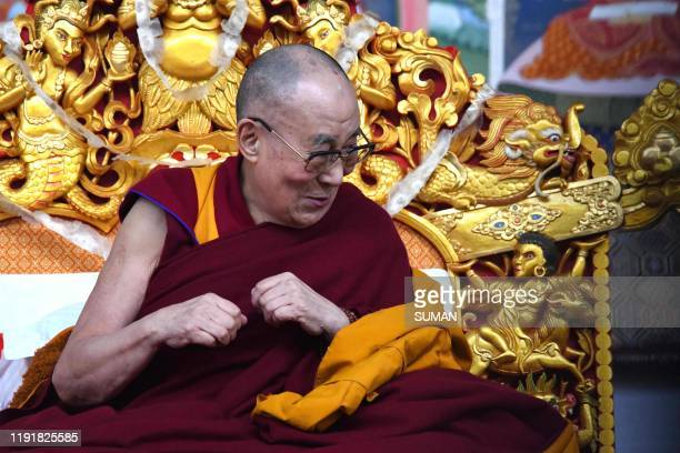 Tibetan spiritual leader the Dalai Lama gestures during the fourth day of a series of teachings in Bodhgaya on January 5 2020