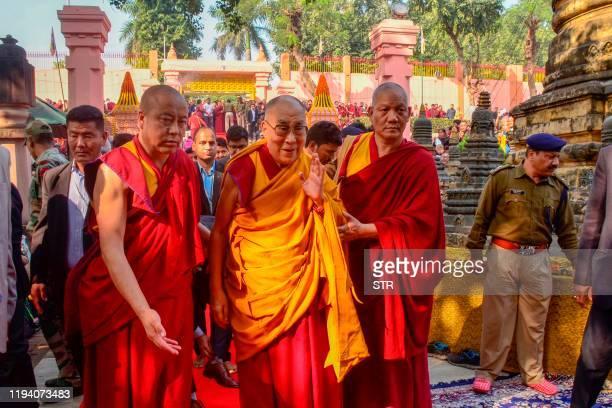 Tibetan spiritual leader the Dalai Lama greets devotees during a visit at the Mahabodhi temple in Bodhgaya on January 17, 2020.