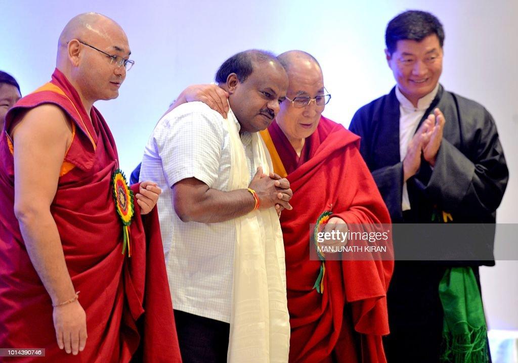 Tibetan spiritual leader the Dalai Lama hugs Karnataka Chief    News