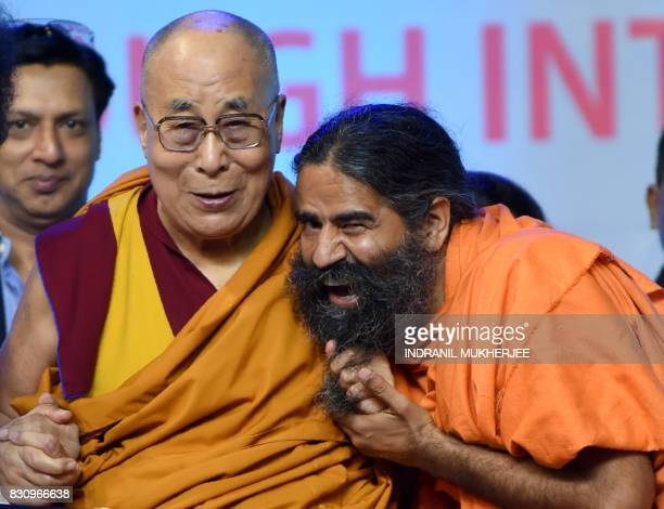 Tibetan spiritual leader The Dalai Lama jokingly pulls Indian yoga guru Baba Ramdev's beard during a inter faith religious conclave ahead of India's...