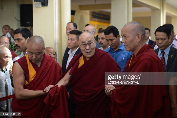 Tibetan spiritual leader the Dalai Lama leaves after attending a conference on Kalachakra Tantra on the occasion of the 600th death anniversary of...