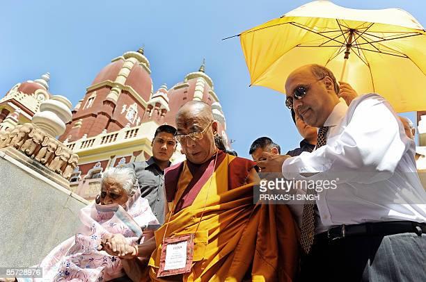 Tibetan spiritual leader the Dalai Lama leaves after prayer at the Birla mandir Hindu temple in New Delhi on March 31 2009 On behalf of the Tibetan...
