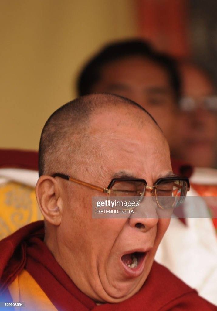 Tibetan spiritual leader The Dalai Lama looks yawns while at the Central school for Tibetans in Kalimpong on December 14, 2010. The Dalai Lama is in Kalimpong, India's West Bengal state, to present teachings to followers. The Dalai Lama during a press conference said he welcomes Chinese Premier Wen Jiabao in his forthcoming visit to India. AFP PHOTO/Diptendu DUTTA