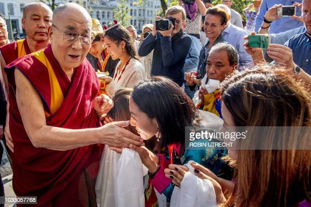 Tibetan spiritual leader The Dalai Lama meets fans after his arrival at the Bilderberg Parkhotel in Rotterdam the Netherlands on September 14 2018...
