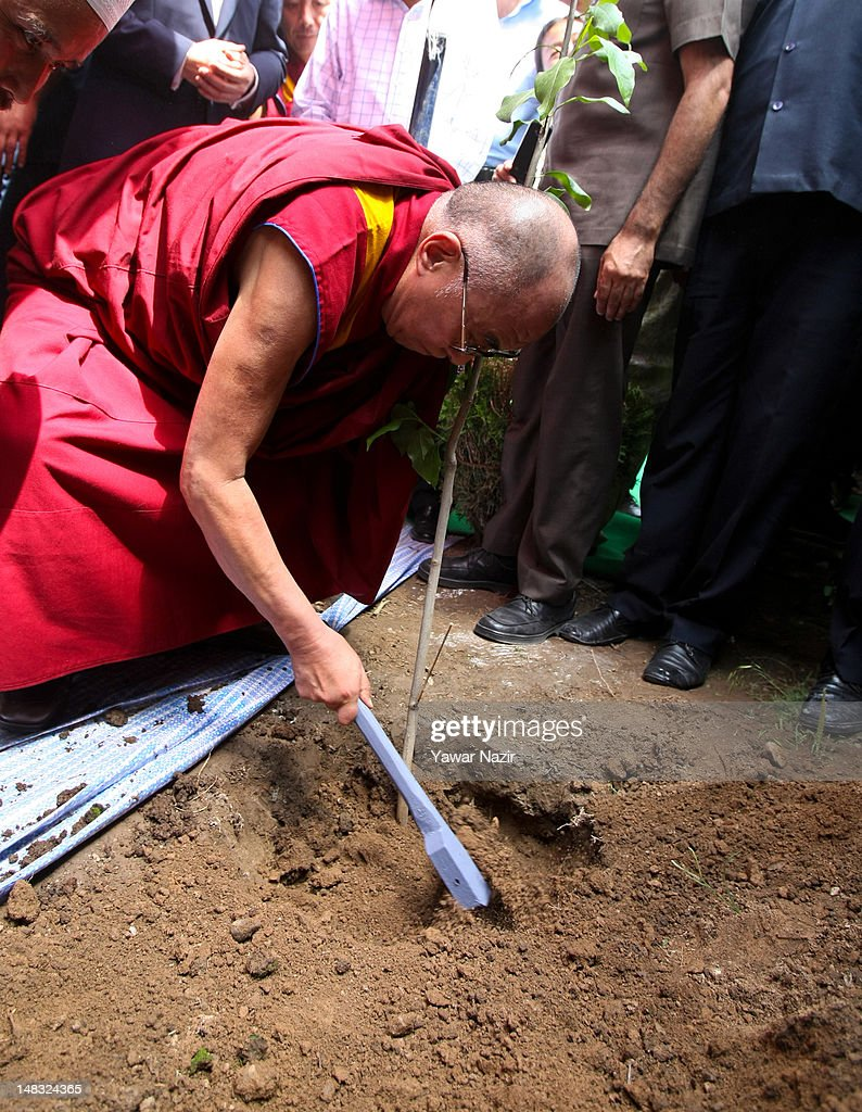Tibetan spiritual leader the Dalai Lama plants a tree during his visit to a Tibetan school on July 14, 2012 in Srinagar the summer capital of Indian administered Kashmir, Indian. The Dalai Lama is in Kashmir for about a week to visit the Tibetan community living in the predominately Muslim area.
