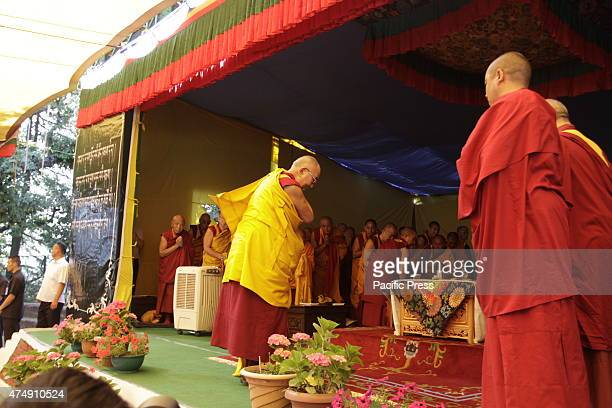 Tibetan spiritual leader the Dalai Lama praying before he starts the teaching to the young Tibetans at TCV about the psychology and the mind and on...