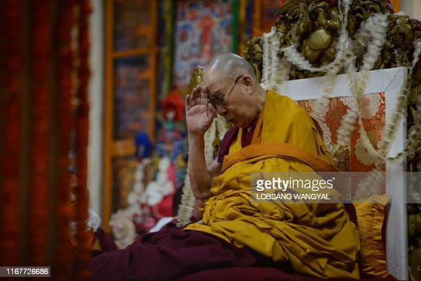 Tibetan spiritual leader the Dalai Lama prays during a longlife prayer offering dedicated to him at Tsuglagkhang Temple in McLeod Ganj on September...