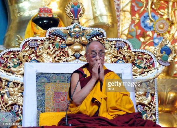 Tibetan spiritual leader the Dalai Lama prays for four Tibetans executed in Lhasa the capital of Tibet for their alleged role in deaths by arson in...
