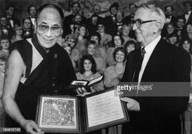 Tibetan spiritual leader the Dalai Lama receives the 1989 Nobel Peace Prize from Egil Aarvik chairman of the Norwegian Nobel Committee on December 10...