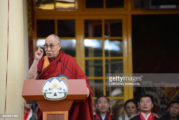 Tibetan Spiritual leader the Dalai Lama speaks during the swearingin ceremony of reelected Sikyong Lobsang Sangay at the Tsuglakhang Temple in McLeod...