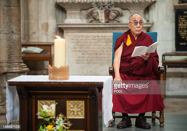 Tibetan spiritual leader the Dalai Lama takes part in a service of prayer and reflection attended by representatives from different religious groups...