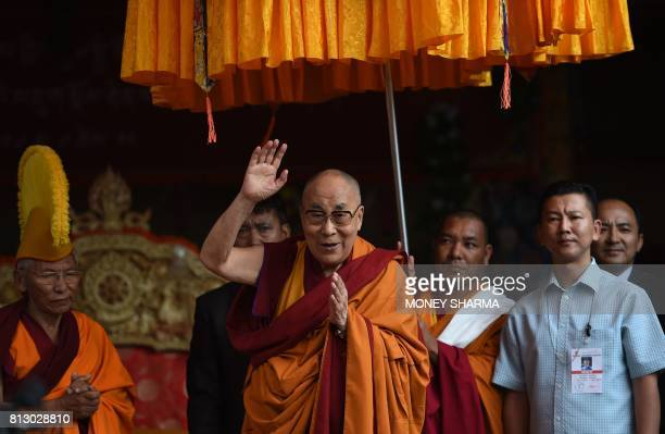 Tibetan spiritual leader the Dalai Lama waves as he arrives for his teachings during the 'Degon Yarchos Chenmo 2017' at the Diskit monastery in the...