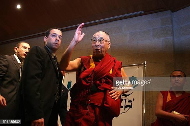 Tibetan spiritual leader The Dalai Lama waves as he leaves a press conference in Jerusalem, Wednesday, February 15, 2006. The Dalai Lama said he...