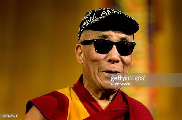 Tibetan spiritual leader the Dalai Lama wears a pair of sunglasses he received after his lecture in Amsterdam on June 4 2009 The Dalai Lama is...