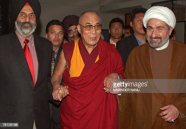 Tibetan spritual leader His Holiness The Dalai Lama walks with fellow religious leaders as they arrive to attend a session of an International...