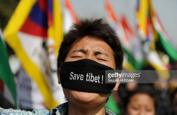 A Tibetan student in exile shouts slogans as he takes part in a protest in New Delhi on February 21 2012 Tibetans together with Delhi University...