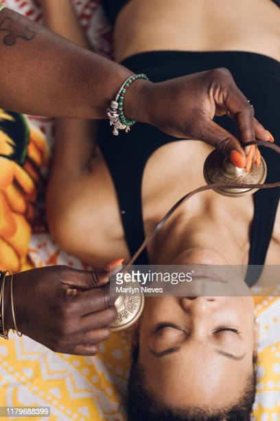 """tibetan tingsha cymbals being used for holistic healing - """"marilyn nieves"""" stock pictures, royalty-free photos & images"""