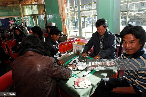 Tibetan villagers play mahjong in their new home in Liuwu Village where the Lhasa Railway Station a terminal of the QinghaiTibet railway is located...
