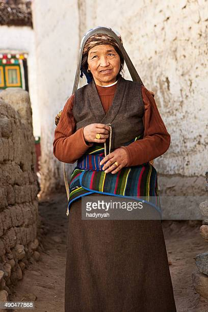 Tibetan woman carrying basket, Upper Mustang, Nepal
