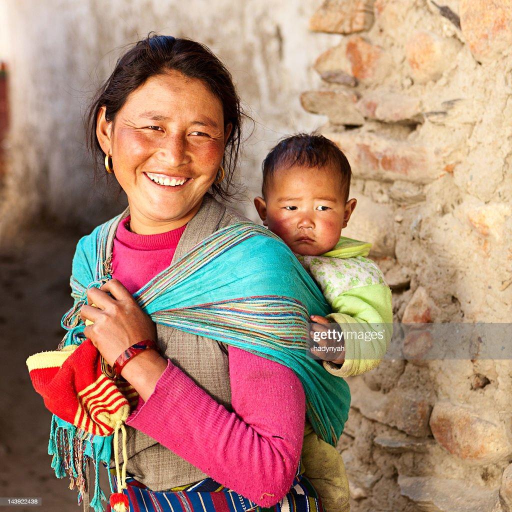 Tibetan woman carrying her baby : Stock Photo
