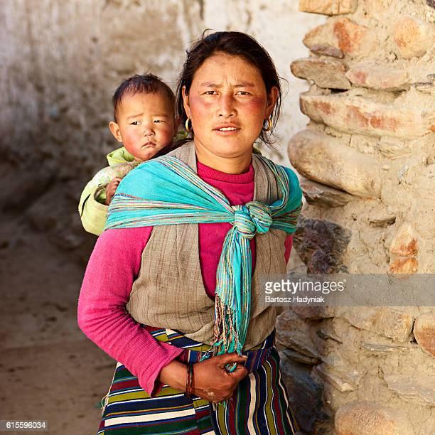 Tibetan woman carrying her baby, Upper Mustang
