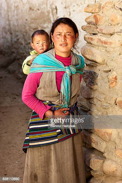 Tibetan woman carrying her baby, Upper Mustang
