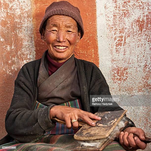 Tibetan woman combing wool in Lo Mantang