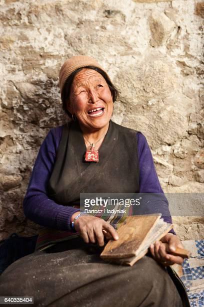 Tibetan woman combing wool in Upper Mustang