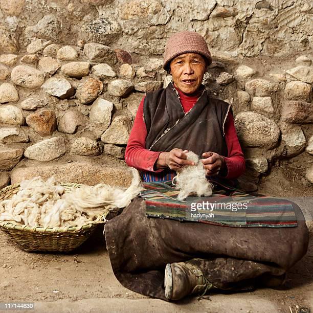 Tibetan woman combing wool