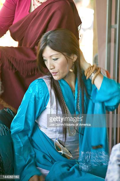 Tibetan woman in traditional dress attends Amitabha Empowerment Buddhist Ceremony Meditation Mount in Ojai CA