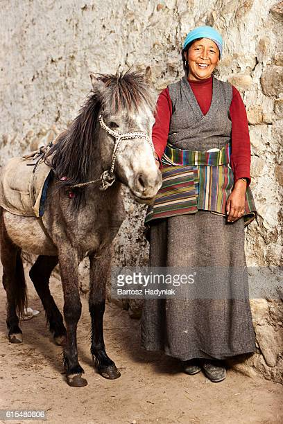 tibetan woman leads her horse, upper mustang, nepal - lo manthang stock pictures, royalty-free photos & images