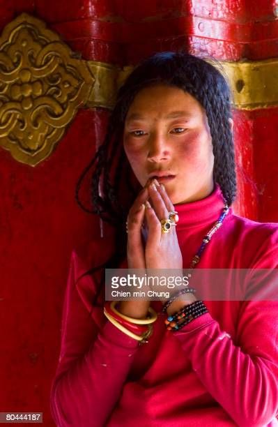 Tibetan woman prays outside of Jokhang temple on September 25 2004 in Lhasa Tibet China has come under recent international pressure over harsh...