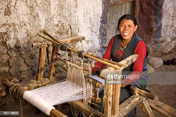 Tibetan woman weaving a carpet