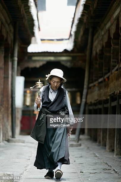 Tibetan Woman with Buddhist Prayer Wheel at Jokhang Monastery, Lhasa, Tibet, China