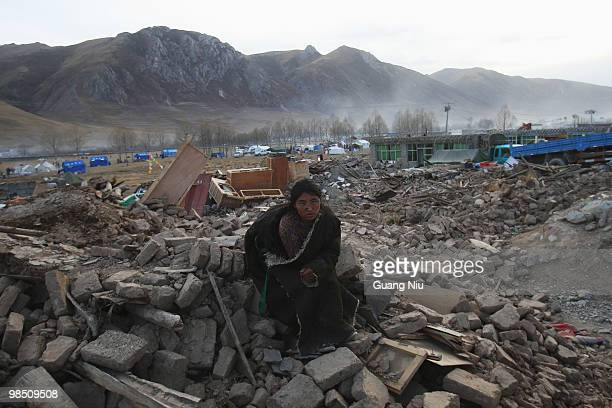 Tibetan women waits for a help during a mass cremation for the victims of a strong earthquake, on April 17 in Jiegu, near Golmud, China. Current...