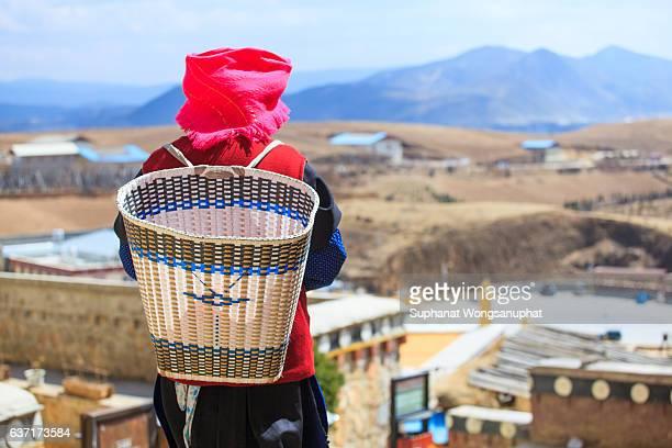 Tibetan women walking at the old town square of Shangri-La