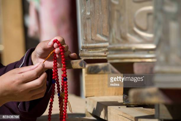 Tibetan young woman in the temple