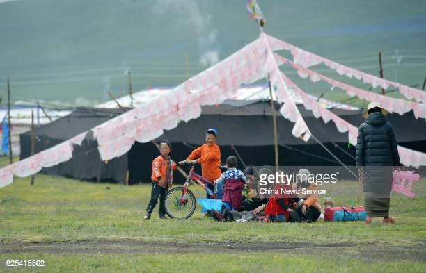 Tibetans and tourists attend a tent festival on a grassland 4500 meters above sea level on August 1 2017 in Shiqu County Sichuan Province of China